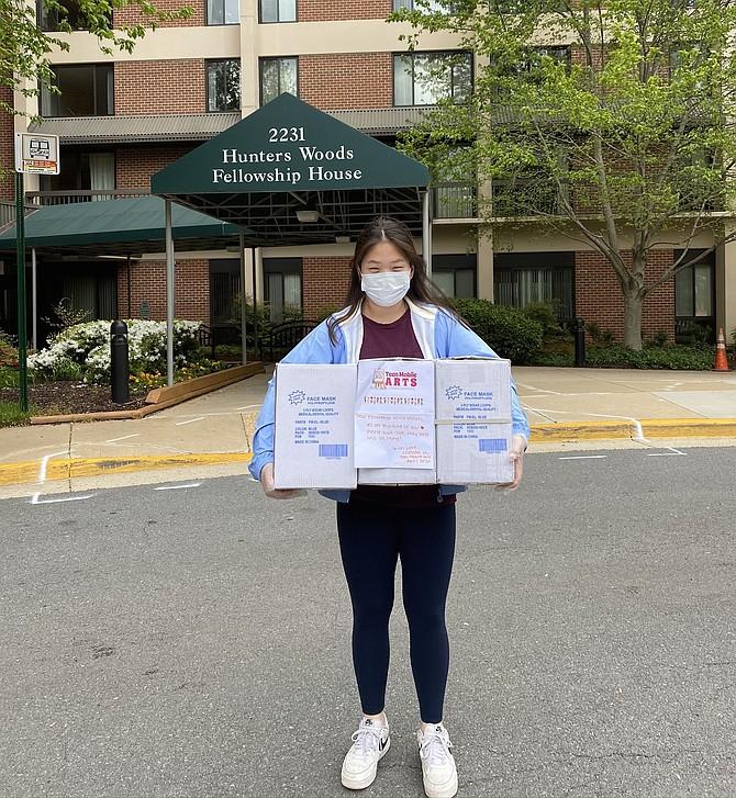 Chelsea Hu delivering face masks to senior homes.