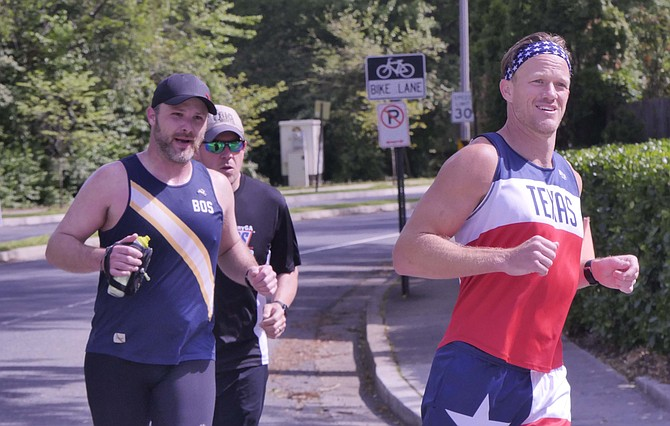 Babb (left) is joined by his friends, Jered, originally from Texas, and Peter, who lives locally, to keep him company on his marathon run.