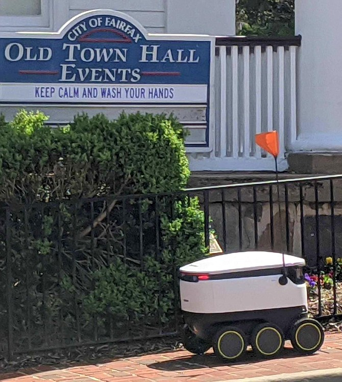 A Starship robot chugs up University Drive on a food-delivery mission.