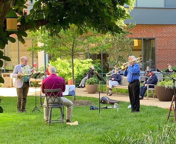 Led by music director James Ross on French Horn, a brass trio from the Alexandria Symphony Orchestra serenades residents at Goodwin House Alexandria during a 30-minute concert on May 7.