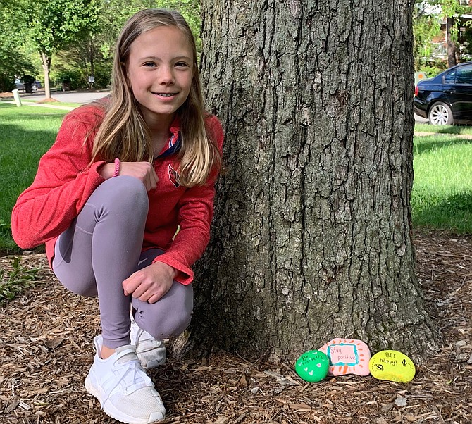Sophie Richardson, a 6th grade student at St. Stephen's/St. Agnes School, displays some of the painted rocks she leaves in her Vauxcleuse neighborhood.