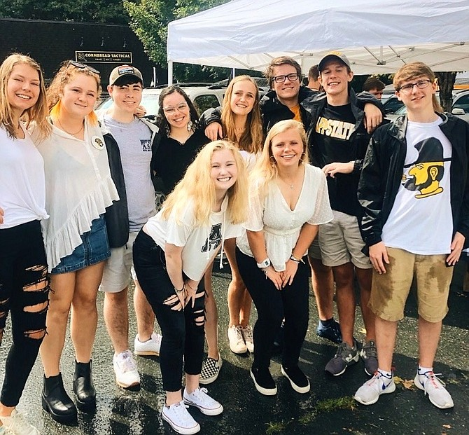 Bailey Shannon, of Vienna,  (bottom left) with a group of friends tailgating at an Appalachian State University football game this past fall.