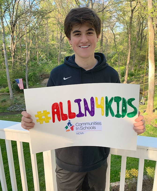 Will Navas holds a sign with the #allin4kids slogan in a post to spread awareness. He is also using the hashtag to track people running and their times through social media posts. The GoFundMe Will Navas set up – gf.me/u/xxy3sz – is where people can pay their registration fee for the 5k.