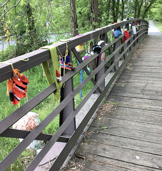 Everyone is invited to add decorations to the footbridge on River Road across from Falls Bridge Road. Many have responded.