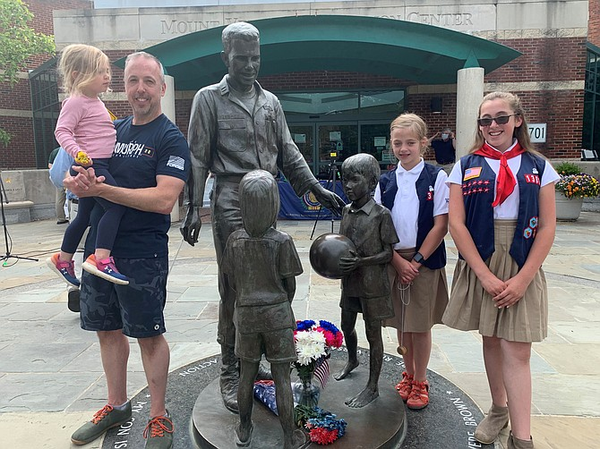 Paul Doerrer, holding daughter Helena, with daughters Lena and Marin at the Rocky Versace Plaza in Del Ray. The family paid a Memorial Day visit to the memorial to honor the city's fallen veterans.