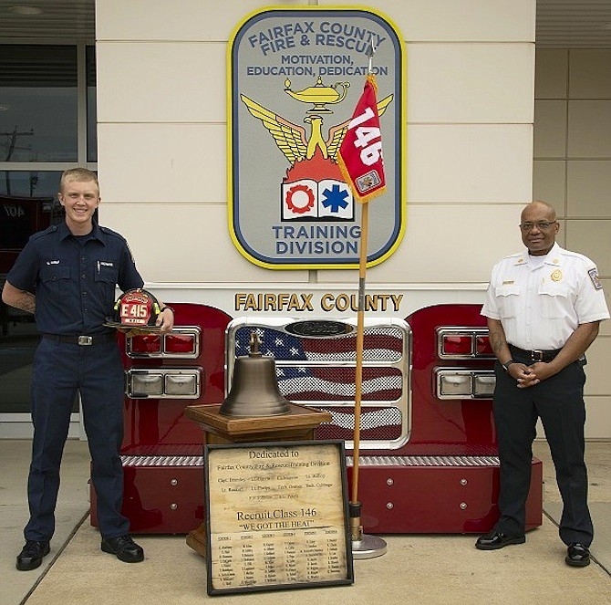 (From left) new firefighter Christopher Wolf and Fairfax County Fire Chief John Butler.