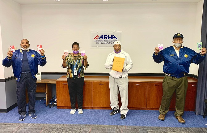 ARHA CEO Keith Pettigrew, second from right, poses for a photo with Departmental Progressive Club president Merrick Malone, left, ARHA resident director Gaynelle Bowden-Diaz, and DPC's William Chesley on May 21 following the presentation of $890 in grocery gift cards from the DPC to ARHA.