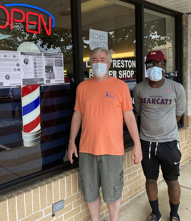 (From left) Chris Dittes and Richard Spencer of Reston wait in line for haircuts, masked and ready to abide with Executive Order 63 requiring all Virginians to wear face coverings while inside public spaces.