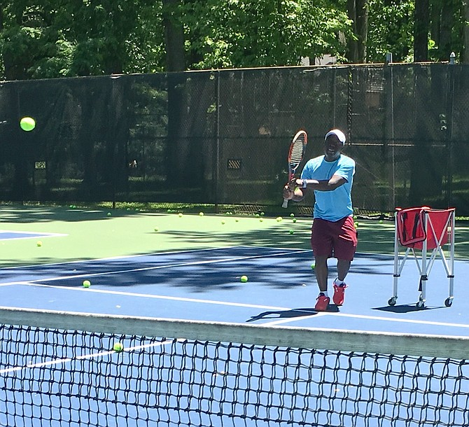 Keanu Owusu, from 4 Star Tennis, gives a private lesson at Potomac Swim and Tennis on Saturday, May 30.