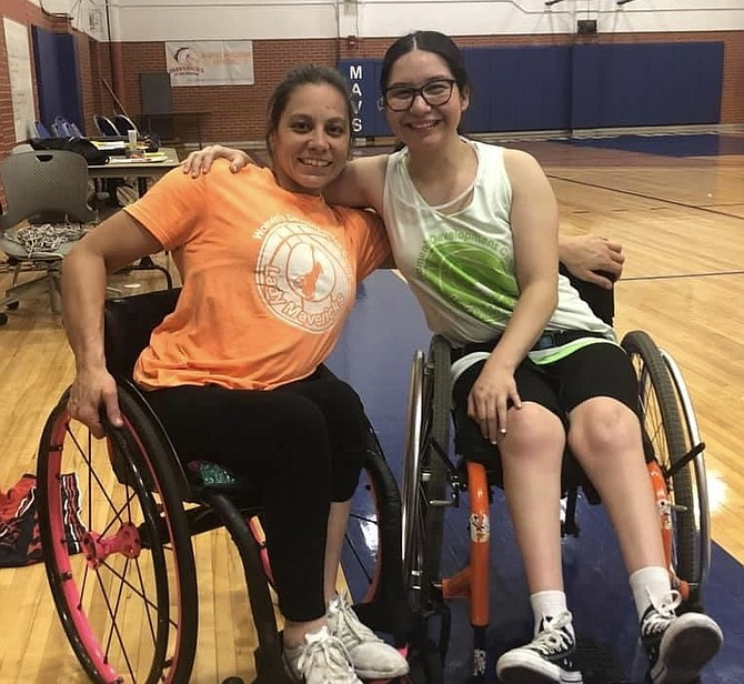 Marissa Flores at the women's wheelchair basketball summer development camp last summer at UTA in Arlington, Texas, with Darlene Hunter a team USA Paralympian and Coach at UTA.