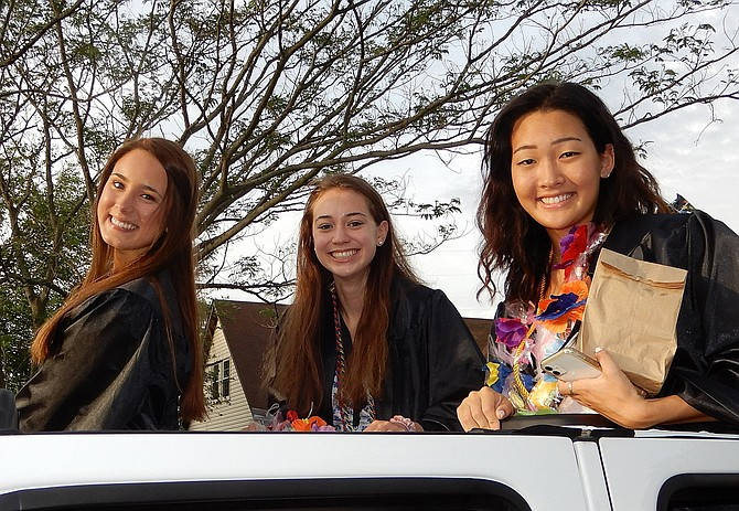 (From left) Kailee Corbett, Ellie Reimer and Taylor Kim smile from a sunroof.