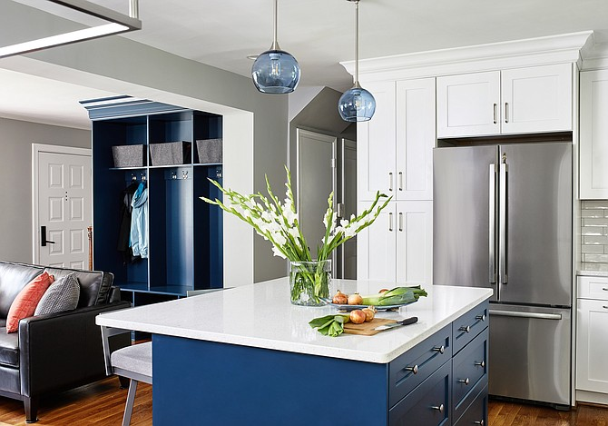 Blue pendant lighting hangs above a white quartz-topped island in this kitchen by interior designer Elena Eskandari, Case Design/Remodeling, Inc.