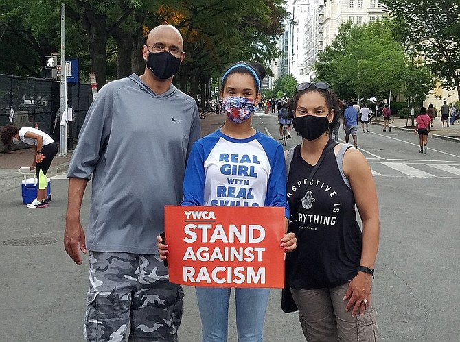 (From left) Centreville residents Erik, Kayla and Jamie Gadley about to join a peaceful protest, last Friday, in Washington, D.C.