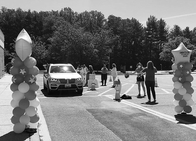 Wootton High School seniors were greeted with balloons and applause when they arrived at the school to pick up caps and gowns last week.