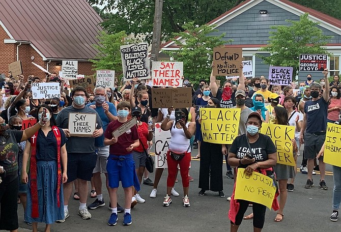 Protesters gather in front of the Charles Houston Recreation Center June 4 to participate in a rally in memory of George Floyd, who died while in police custody May 25 in Minneapolis.