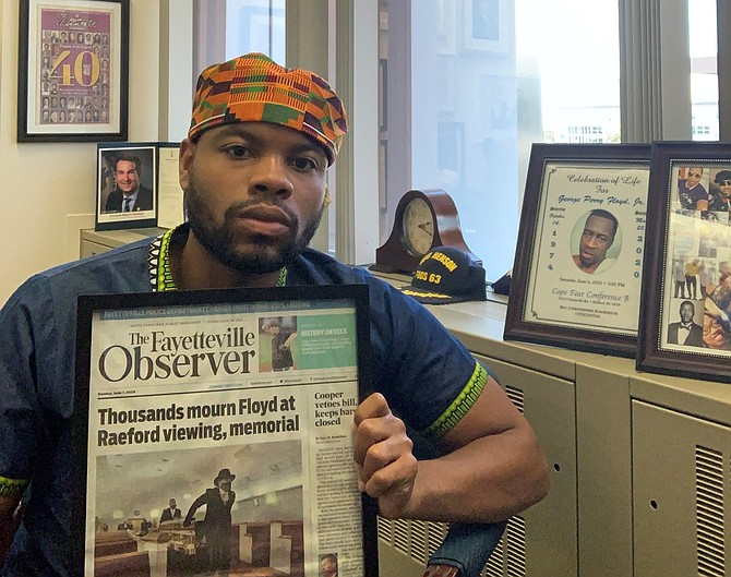 Local attorney Tavares Floyd holds a newspaper clipping detailing the private family memorial held June 6 for his cousin George Floyd. The May 25 death of George Floyd during an arrest in Minneapolis has sparked weeks of protests across the country.