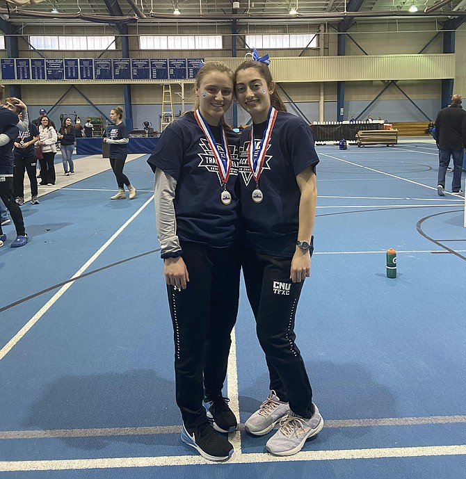 Lindsey Stirling (left) of Falls Church with Adrianna DeSantis (right) at Christopher Newport University's indoor track at the Freeman Center, after their track team won their conference meet in February.