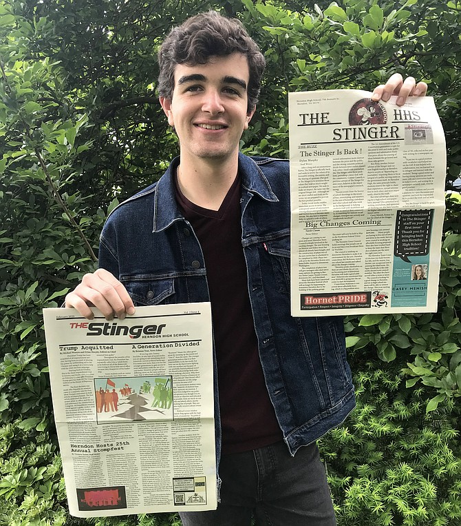 Michael Wemyss, editor-in-chief of Herndon High newspaper,  holds his first (right) and last (left) issues.