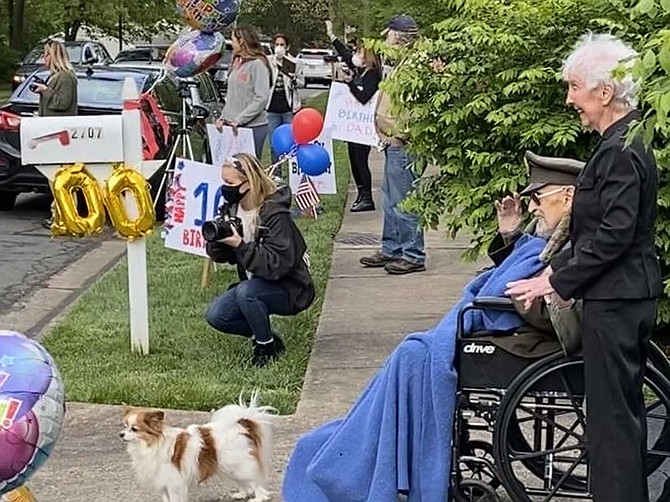"Retired Air Force Col. Robert A. ""Bob"" Shawn, Herndon Centenarian and former Air Force fighter pilot, at his 100th birthday drive-by parade on May 6, 2020, organized in his honor by comrades at the Veterans of Foreign Wars Loudoun County Post #1177."