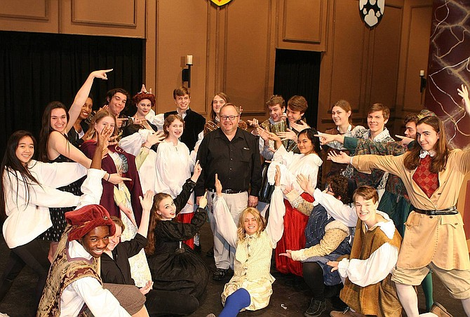 "Centreville High Theater Director Mike Hudson (center) and the cast of 2017's ""Twelfth Night."""
