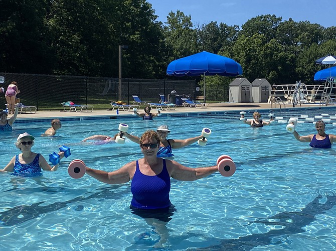 On opening day, June 29, the water aerobics class is underway in the cool waters of Lake Newport pool operated by Reston Association.