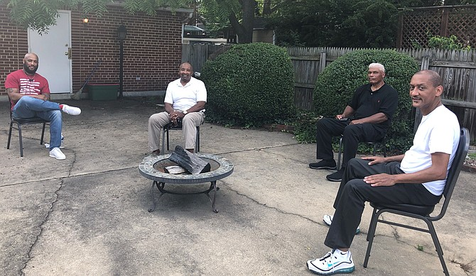 Chris Harris, Merrick Malone, William Chesley and Harry White of the Departmental Progressive Club gather June 25 at the DPC to discuss efforts to change the name of T.C. Williams High School. Williams, a former ACPS superintendent, was an avowed segregationist.