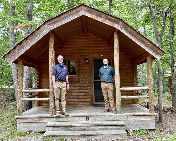 "Paul Gilbert and Brad Jackson outside Pohick Bay Park ""Rustic"" cabin."