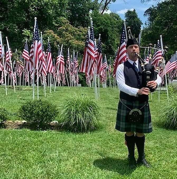 Bagpiper Adam Tianello performs Amazing Grace at the Flags for Heroes display June 28 at Cedar Knoll Restaurant.