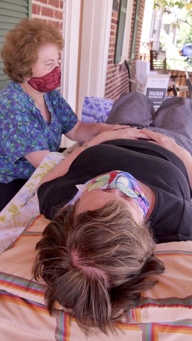 Lisa Shimberg treats a long-time patient, Mary Jane Ruhl, for fibromyalgia.