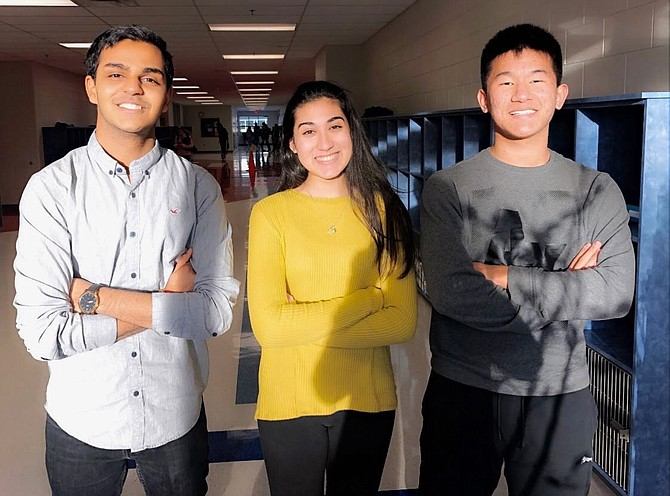 "(From left) Award winners from Thomas Jefferson High School for Science and Technology, Umang Jain of Fairfax, Vyomika Gandhi of Aldie and Justin Choi of McLean: ""Our product aims to prevent the onset of opioid addiction through our secure pill dispenser, but also injects Naloxone through micro-needle patches to save lives when an overdose is detected."" (Photo taken students' junior year, 2019-2020 before COVID-19.)"