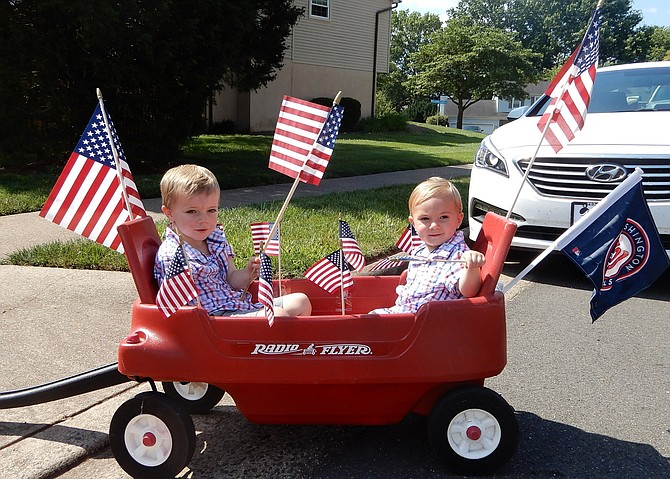 (From left) The Small brothers, Landon, 3, and Carter, 1, in their wagon.