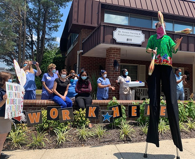 Mount Vernon Nursing and Rehabilitation Center staff watch a juggler brought to the facility June 30 by Synergy Home Care in a show of appreciation for their dedication during the COVID-19 pandemic.