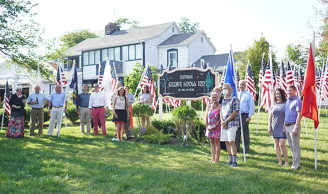 Sponsors of the Flags for Heroes program gather for a photo on the lawn of Cedar Knoll Restaurant for a July 9 reception.
