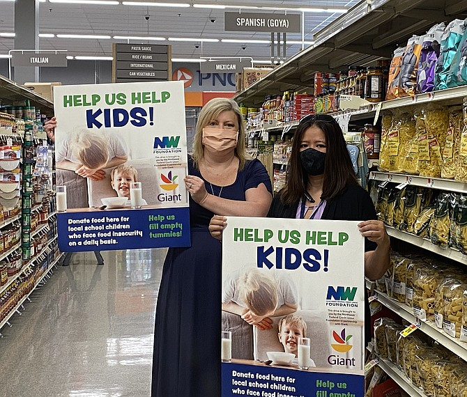 "Mary Kaye ""Kaycee"" Childress, Executive Director of the Northwest Federal Credit Union Foundation, the philanthropic arm of Northwest Federal Credit Union, and Pham Ngocmy of the Giant Food store located at 2425 Centreville Road in Herndon."