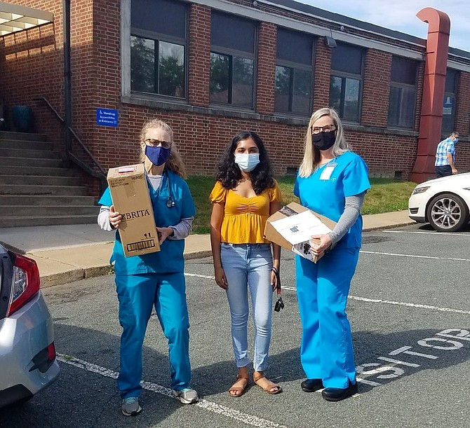 Rachana Subbanna, a junior at the University of Virginia, dropping off 25 devices this week at the Charlottesville Free Clinic.