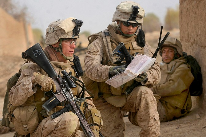 U.S. Marine Corps Staff Sgt. Ryan Clay, left, and Cpl. Anthony Deprimo study a map while on a patrol in Marjah in Helmand province, Afghanistan, Feb. 21, 2010. Clay and Deprimo were assigned to India Company, 3rd Battalion, 6th Marine Regiment.
