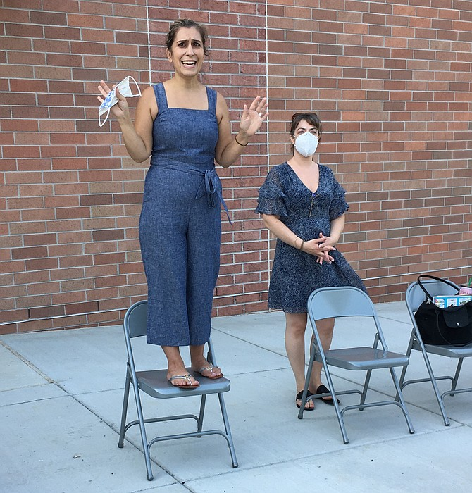 Outgoing Potomac Elementary School PTA President Golru Ghaffari opens the group's first ever outdoor meeting Thursday. To her left is President elect Susana Zhuo.