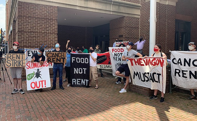 Residents of Southern Towers protest during eviction hearings July 15 outside the Franklin P. Backus Courthouse in Old Town. Organized by residents and the Metro D.C. Democratic Socialists of America, the protest called for the cancellation of rent payments.