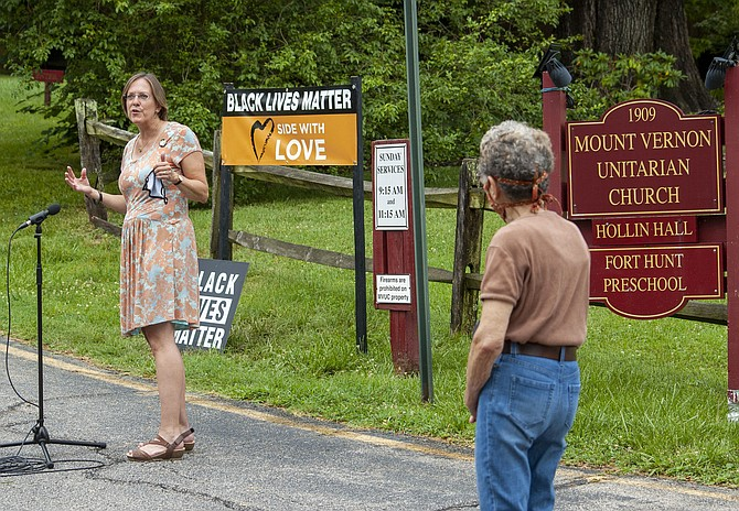 "Rev. Kate Walker dedicates a ""Black Lives Matter"" sign at the entrance to the Mount Vernon Unitarian Church on Windmill Lane."