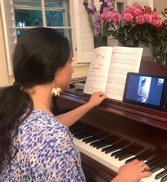 Kristina Markarian teaches piano online by Zoom from her studio in McLean.