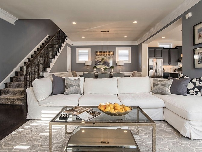 This free-flowing living room and dining room was designed by Quintece Hill-Mattauszek of Studio Q Designs in Alexandria.