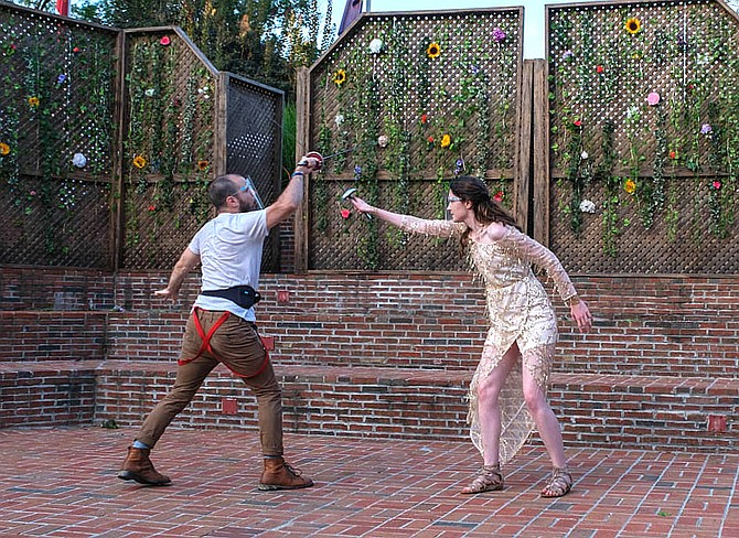 Fencing are Justin Winters (as Duke Theseus) and Isabelle Baucum (as Hippolyta).