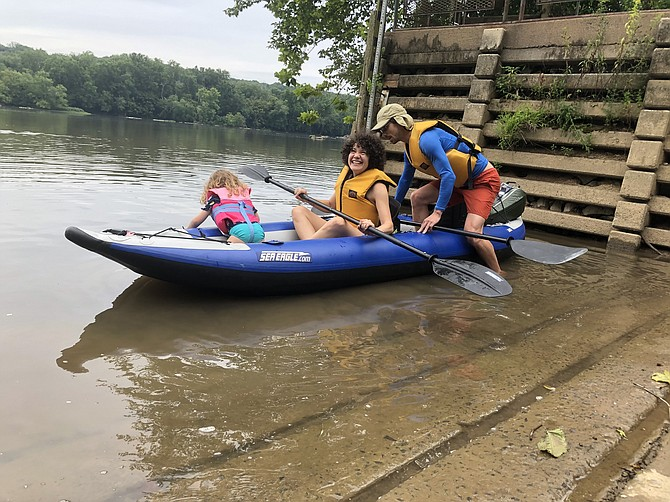 Tom and Anita Breach, along with their daughter Flora, push off from Riverbend's boat ramp, ready to enjoy a cool day on the river.