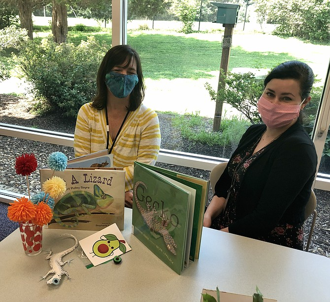 From left: Great Falls Library Branch Manager Andrea Spira and Youth Services Manager Devin Parris pose with craft kits.