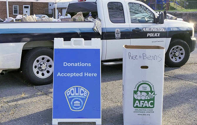"Arlington County Police Department holds ""Fill the Cruiser"" food drive for Arlington Food Assistance Center on Aug. 11."