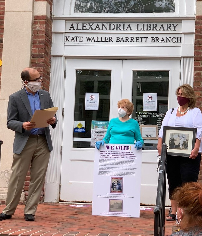 Mayor Justin Wilson, left, prepares to read a proclamation recognizing the 100th anniversary of the 19th Amendment Aug. 18 at the Kate Waller Barrett Library. Council members Del Pepper and Amy Jackson joined the ceremony that celebrated the amendment granting women the right to vote.