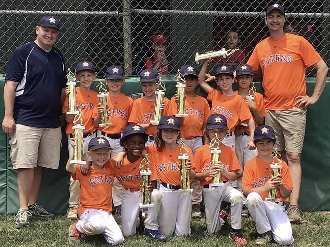 The Great Falls Astros celebrate a championship victory in Spring 2019. Back row (from left): Dan Ryan, Trey Donovan, Clay Rossen, Morgan Rossen, Lachen Singh, Ian Byrd, Dominic Gaudiano, Mike Byrd. Front row (from left: Connor Sarin, Tyson Armah, Emma Ryan, Owen Conrad, Jude Miller.