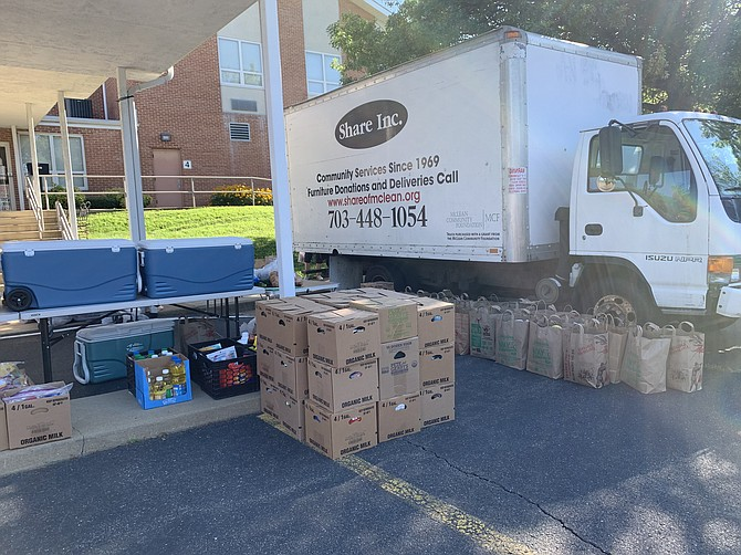 Grab-and-go food containers await distribution on Wednesday morning. Share volunteers now carry boxes to clients' cars to maintain social distance on the twice-weekly distribution days.