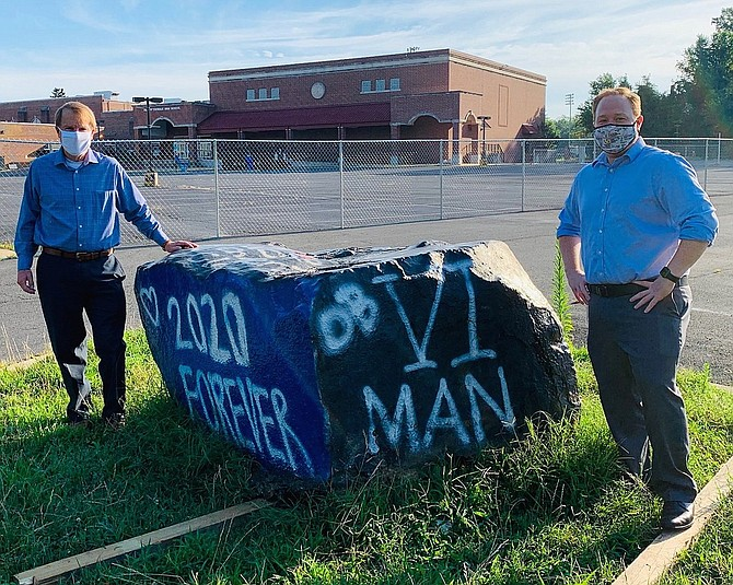 (From left) Fairfax City Mayor David Meyer and Economic Development Director Chris Bruno were on hand when Paul VI's spirit rock was moved from the City.