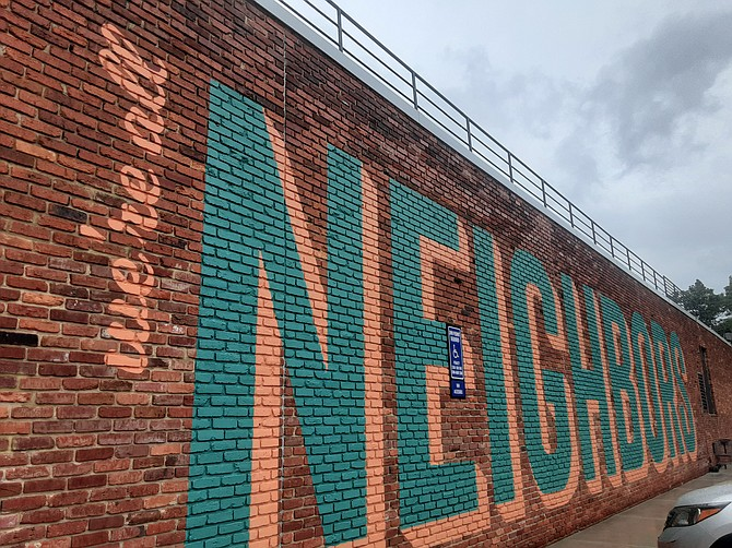 We're All Neighbors is the message at the Keene Mill Shopping Center in Springfield.